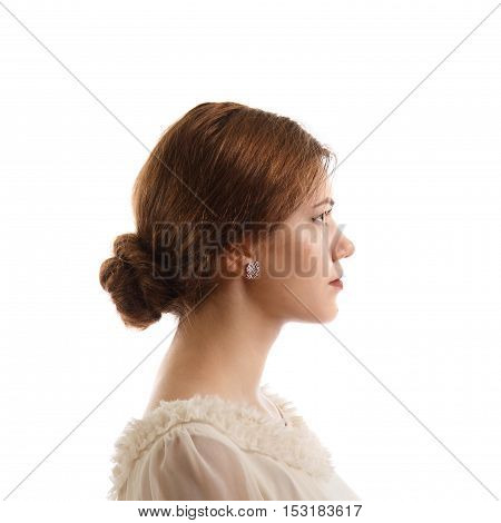 A side view of a young female in a dress