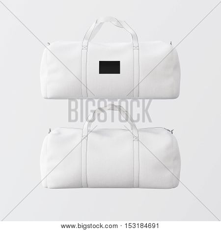 White cotton textile sport fashion bag with handles isolated at empty background.Clean black mockup label on the front side.Double sided mock up.3D rendering.