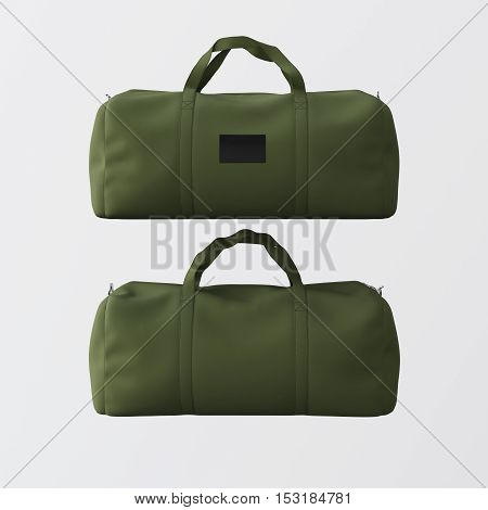 Sport fashion bag of green color with handles isolated at the white background.Highly detailed texture materials in square photo.Empty mockup label on front side.Double sided mock up.3D rendering.