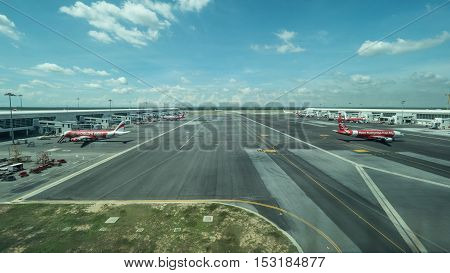 KUALA LUMPUR, MALAYSIA - NOVEMBER 05, 2015: Airplanes parking and waiting on flying line in Kuala Lumpur airport