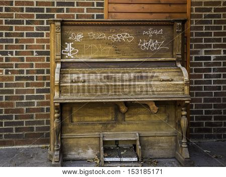 KITCHENER, CANADA - OCTOBER 7, 2016: An old player piano at the outside entrance to The Boathouse, a popular pub and nightclub in downtown Kitchener.