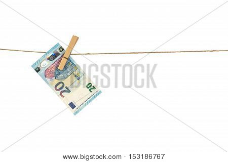 20 Euro Banknote Hanging On Clothesline On White Background.