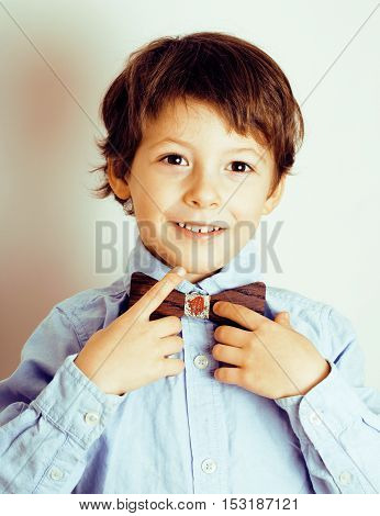 little cute boy in bowtie smiling, making funny faces, stylish casual kid, lifestyle hipster people concept close up