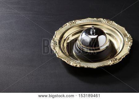 service bell in a golden tray