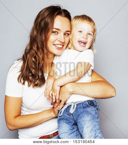 mother with daughter together in bed smiling, happy family close up, lifestyle people concept, cool real modern family close up