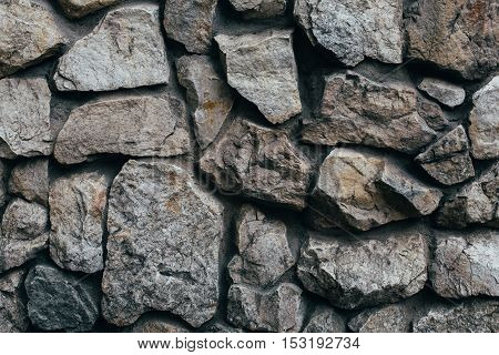 Grey stone wall of manual clutch, texture, background pattern