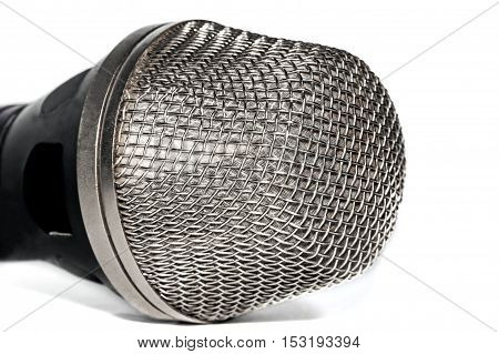 The head of the microphone on ligth background