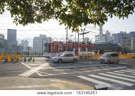 Nagasaki, Japan - February 28, 2016 Cars And Vintage Tram On The Road