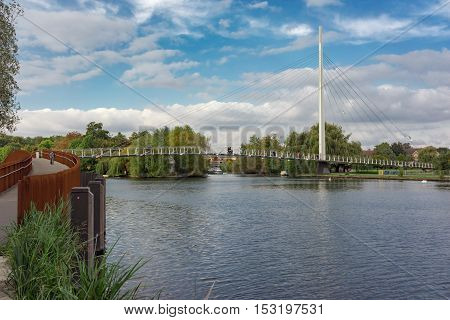 Riverside scene of the Christchurch foot bridge over the River Thames in Reading, UK.