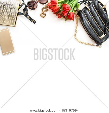 Fashion still life with accessories flowers phone. Feminine objects on white background