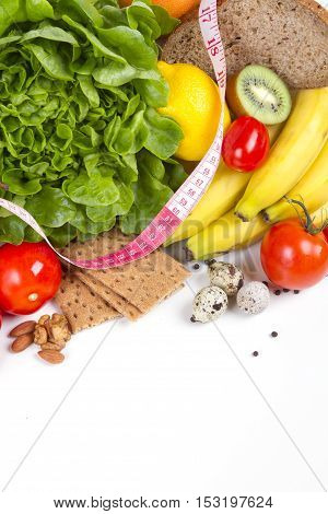 Diet weight loss breakfast concept - organic green salad pears grapefruit tomatoes. pumpkin quail eggs nuts grain bread - healthy food. vertical shot