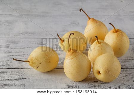 Fresh Ripe Organic Pears On A Rustic Wooden Table