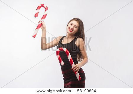 Young Beautiful Girl With Red Lips With Christmas Candy On Isolated White Background.