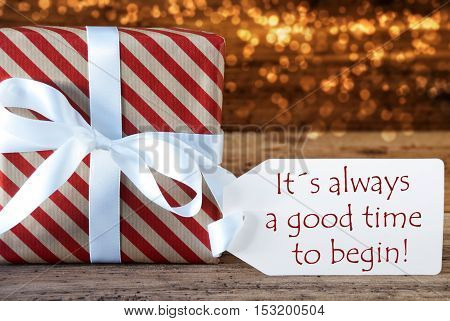Macro Of Christmas Gift Or Present On Atmospheric Wooden Background. Card For Seasons Greetings, Best Wishes Or Congratulations. White Ribbon With Bow. English Quote Always A Good Time To Begin