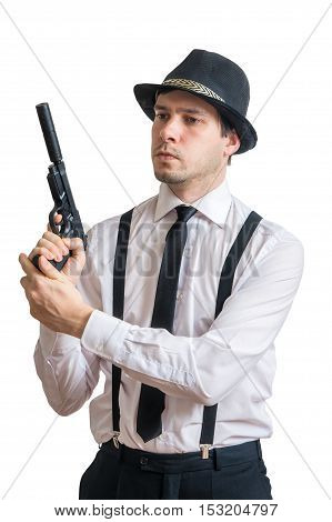 Young Mafia Man Or Detective Holds Gun In Hands. Isolated On Whi