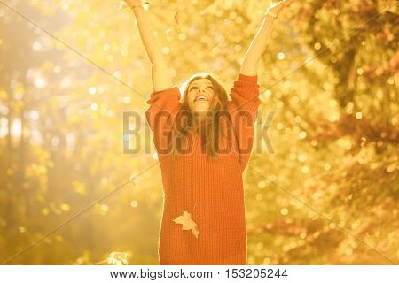 Joyful Girl Having Fun With Leaves In Autumnal Park.
