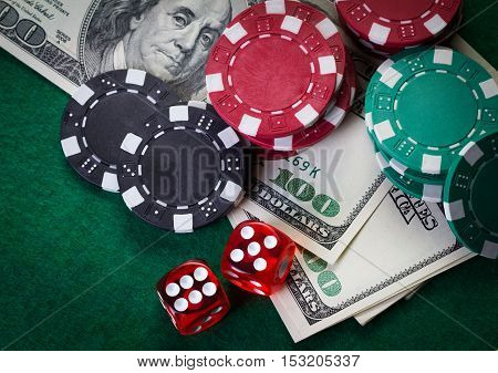 money and casino tools on green table