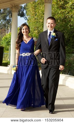 High School Students Going to the Prom.  Outside Photos of an attractive young teenage couple. They are walking and look very happy