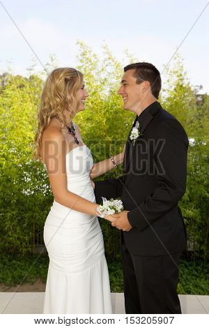 High School Students Going to the Prom.  Outside Photos of an attractive young teenage couple looking at each other