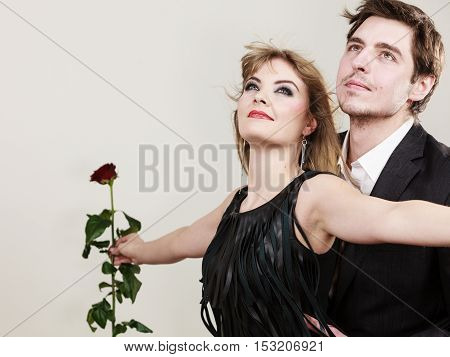 Love in air. Freedom of feelings. Charming gorgeous couple wearing elegant clothes in gust of wind. Enamoured fabulous woman and man making titanic gesture.