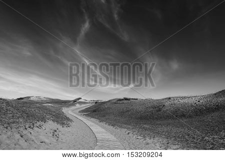 Wooden road in the sand dunes. Curonian Spit, Lithuania. Black and White photo