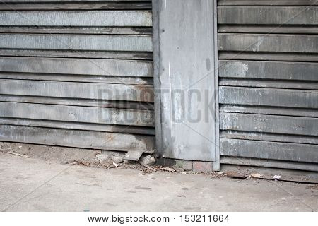 Dirty rusty industrial roller security door to warehouse