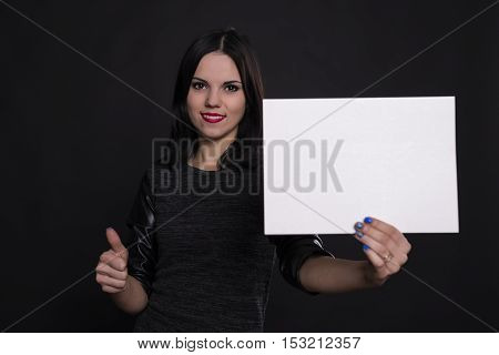 girl with a paper in his hand in the studio