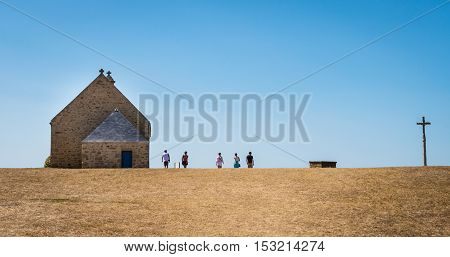 Ancient stone church and cross on the horizon