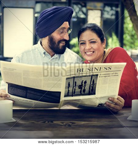 Indian Couple Reading Newspaper Concept