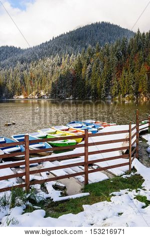 First snow at Lacul Rosu, the Red Lake or Killer Lake, Eastern Carpathians, Transylvania, Romania
