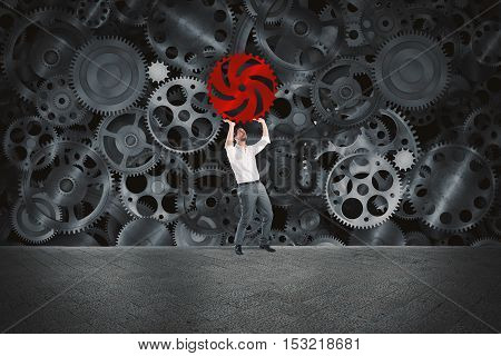 Businessman builds a business system as a gears mechanism and puts the missing gear