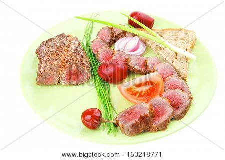 meat food : bbq meat served on green plate with tomatoes and sprouts isolated on white background