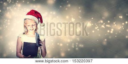 Girl With Santa Hat Opening Gift Box