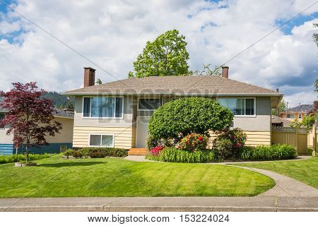 Average North American family house on cloudy sky background
