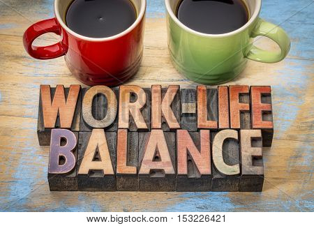 work life balance concept- word abstrac tin vintage letterpress wood type with two cups of coffee