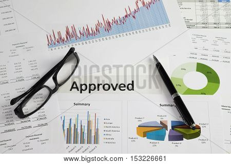 Document approved with business background on business desk