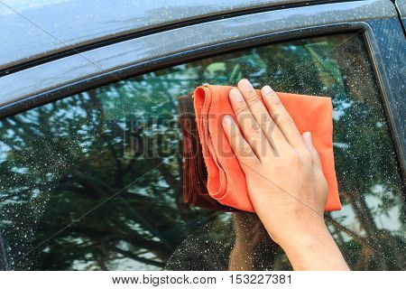 Hand Hold A Fabric Wiping Dirty Car