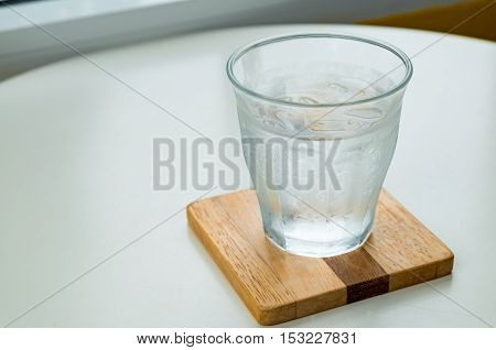 Drinking cold water is poured into a glass.