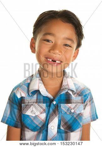 Cute Filipino Boy on a White Background with a big smile that shows his two front teeth are missing