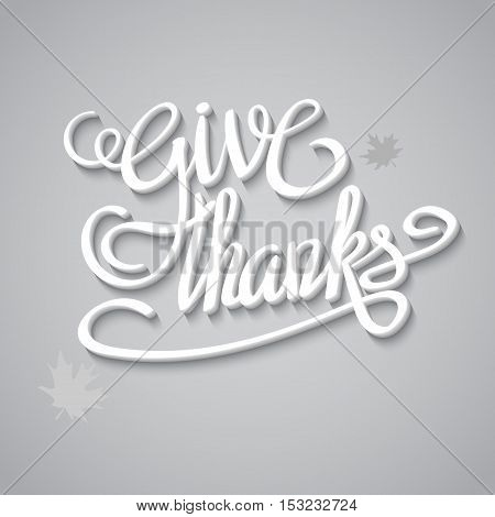 Happy thanksgiving day greeting card with hand lettering on bright background. Give thanks three-dimensional volumetric text with shadow
