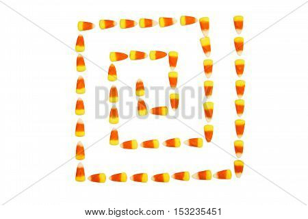 candy corn maze isolated on white background. square maze of sweets. the concept of unhealthy eating, excess sugar and sweets for Halloween. trick or treat