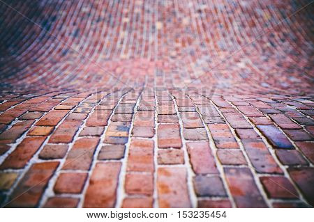 brick pavers on the wavy surface. background of the brick pavement at the hilly surface. sidewalk, pavement texture