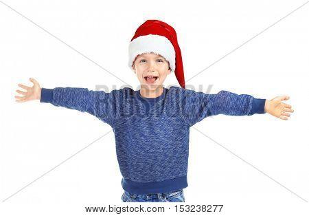 Cute little boy in Santa hat on white background