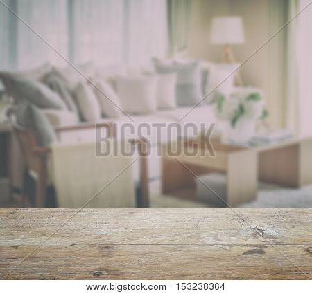 Wooden Table Top With Blur Of Modern Living Room Design With Sofa And Wooden Lamp