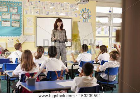 View from doorway of teacher taking primary school class