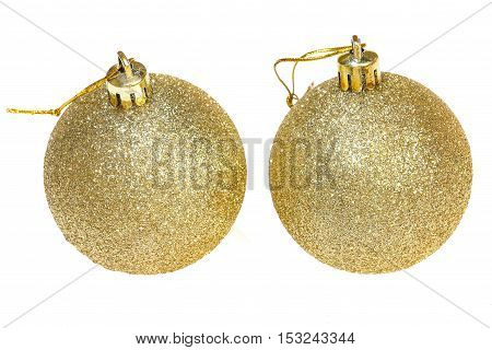 two golden christmas decoration balls isolated on white