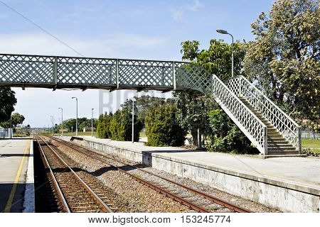 overhead walkway at a railway station to allow passengers to cross the tracks safely.