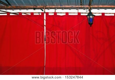 Bright Red Shade Curtain Background In Sunny Backlit.
