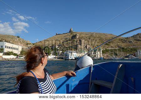 Mature Woman Is On Motor Boat In Balaklava Bay, Crimea.