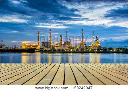 Twilight scene of oil refinery plant on blue skies background.